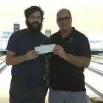 Charles Fletcher received his $800 check from Sarasota Lanes owner Tom Hubbard.  Charles shot the first 800 of the season at Sarasota Lanes.